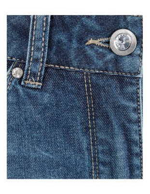 Washed jeans with ornamental stones and decorative stitching