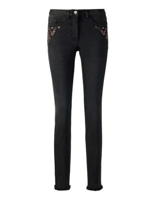 Power-stretch jeans with ornamental stone embellishment and fringed hem