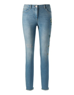 Embellished jeans with frayed hems