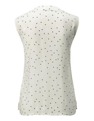 Sleeveless polka dot blouse